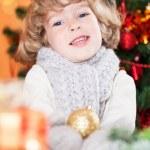 Happy child holding Xmas ball — Stock Photo
