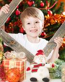 Happy boy playing in Christmas — Stockfoto