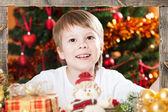 Boy holding wooden frame — Stock Photo