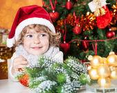 Happy child in Santa's hat — Stock Photo