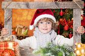 Happy child holding frame — Stock Photo
