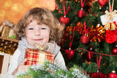 Happy child holding present — Stock Photo