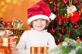 Happy smiling child in Santa's hat — Stock Photo