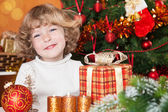 Happy child with gift — Stock Photo