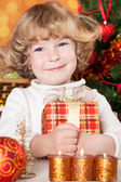 Happy child holding gift box — Stock Photo