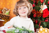 Happy child on the Christmas eve — Stock Photo