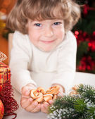 Funny child holding cookies — Stock Photo
