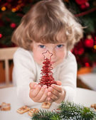 Happy child holding Xmas decoration — Stock Photo