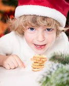 Funny child in Santa's hat — Stock Photo