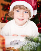 Funny smiling child in Santa's hat — Foto de Stock