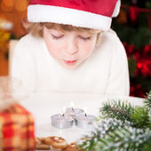 Funny child in Santa's hat — Stock Photo