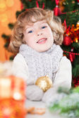 Happy child holding Xmas ball — Stock Photo