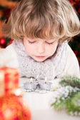 Child blowing out candles — Stock Photo
