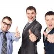 Three young business men laughing and giving the thumbs up sign — Stock Photo