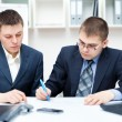 Two young business sitting at desk working in team togeth — Stock Photo