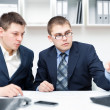 Two young businessmen working together with computer at office d — Stock Photo #11589294