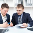Two young businessmen working together in office — Stock Photo #11589308