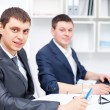 Two young business men working together at office — Stock Photo