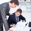 Two young business men signing papers at office — Stock Photo