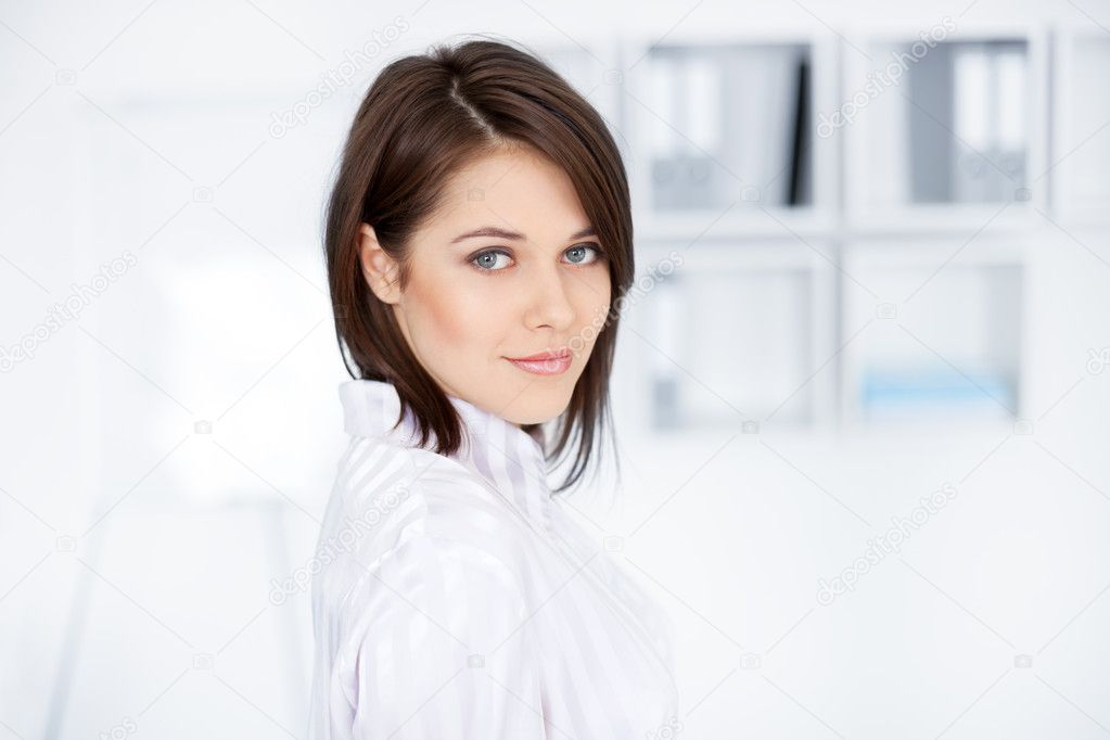 Closeup portrait of beautiful young business woman at office — Stock Photo #11589536