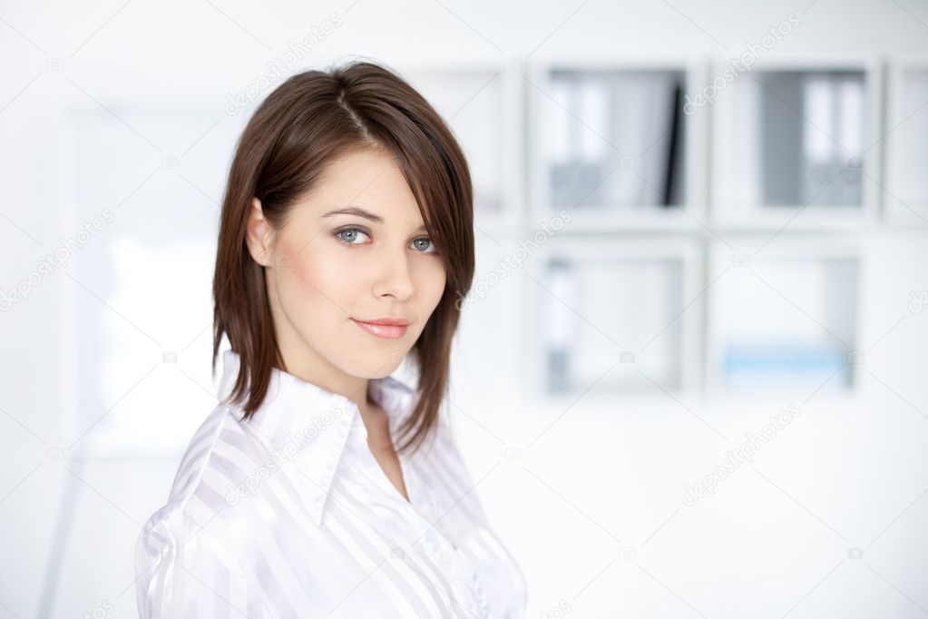 Closeup portrait of beautiful young business woman at office — Stock Photo #11589551