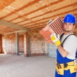 Worker carry brick on construction site — Stock Photo