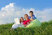 Woman with kids hanging out relaxing — Stock Photo