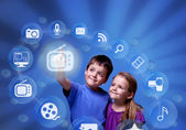 Kids accessing modern entertainment applications from the cloud — Stock Photo