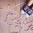 Stock Photo: Problem - child feet and long twisted shoelaces