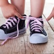 Stock Photo: Child successfully ties shoes