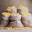 Pasta variety in burlap bags — Stock Photo