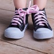 Stock Photo: Partial success - child tied two shoes together