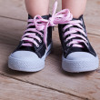 Partial success - child tied two shoes together — Stock Photo
