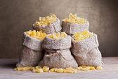 Pasta variety in burlap bags — Stock Photo