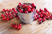 Cherries on wooden board — Stock Photo