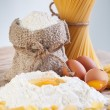 Stock Photo: Ingredients for making past- flour and eggs