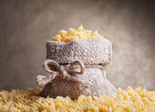 Pasta in burlap bag — Stock Photo