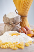 Ingredients for making pasta - flour and eggs — Stock Photo