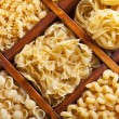 Assorted pasta in wooden compartments — Stock Photo #11535209