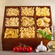 Assorted pasta mix in wooden box — Stock Photo