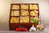 Assorted pasta mix in wooden box — Стоковое фото
