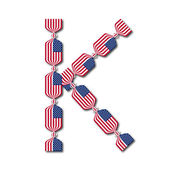 Letter K made of USA flags in form of candies — Stock Vector