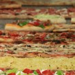 Different varieties of pizza — Stock Photo #11089772