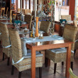 Stock Photo: Wicker chairs and table in restaurant