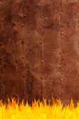 Grunge rusty surface on fire — Stock Photo