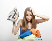 Woman wth laundry and iron — Stock Photo