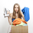 Woman wth laundry and iron — Stock Photo #11844129