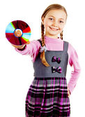 Little Schoolgirl with a disk in his hand — Stock Photo