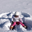 Girl lies on snow. Snow angel — Stock Photo