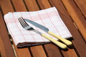 Knife and fork on colored cloth — Stock Photo